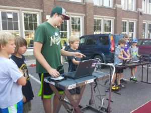 DNA students demonstrating to LEGO Camp how to drive the high school robots