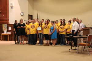 DNA Robotics Team accepting a Certificate of Recognition from the ISD 709 School Board